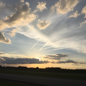 On May 26, 2015 looking in the sky you can see the Jet streaking across the sky people going to coming what a busy world we live in find time to pray